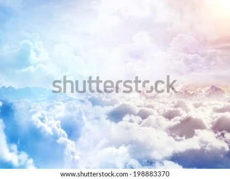Over the Clouds. Fantastic background with clouds and mountain peaks Royalty-Free Stock Photo #198883370
