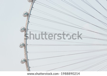 Close-up details of the Ferris wheel with metal beam guides and passenger booths. Dubai Eye on Bluewaters island Royalty-Free Stock Photo #1988890214