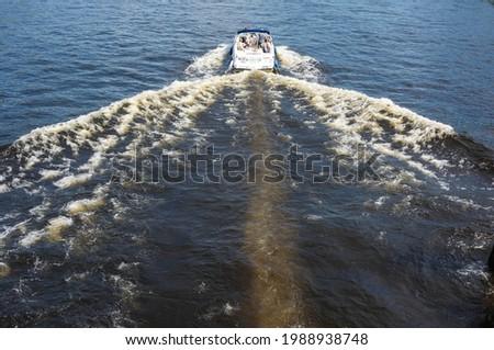 speedboat riding on the lake, speedboat riding on the river, boat trips, boat fishing, boat trips. Royalty-Free Stock Photo #1988938748