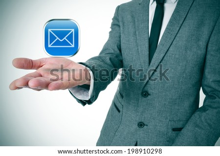 a businessman with a message icon in his hand depicting the instant messaging apps Royalty-Free Stock Photo #198910298
