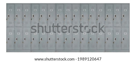 row of vintage grey metal lockers used in school, gyms or pool, grunge metal cabinets in changing room with lock, storage furniture on white background Royalty-Free Stock Photo #1989120647
