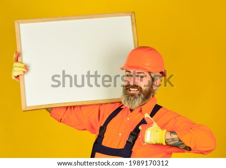 Visual outline. Troubleshoot concept. Bearded man repairman builder. Plan repair works. Repairman hold whiteboard copy space. Handsome repairman. Architect showing project. Professional repairman Royalty-Free Stock Photo #1989170312