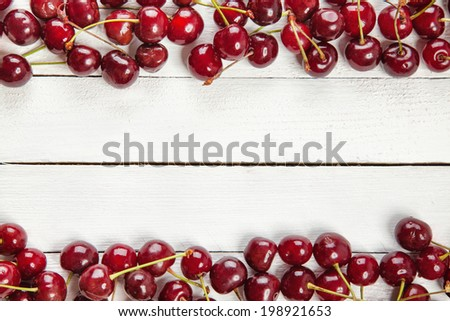 Heap Of Fresh Red Cherries On White Boards #198921653