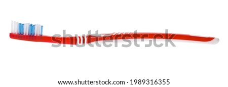 Red toothbrush isolated on white background. Detail for design. Design elements. Macro. Food. Background for business cards, postcards and posters.