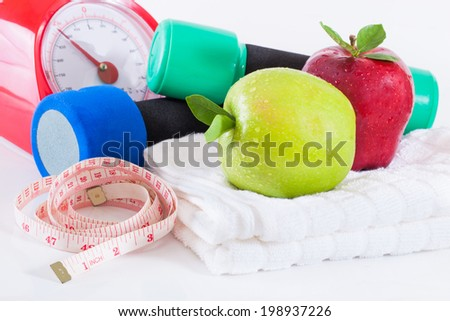 Dumbells with measuring tape and apples #198937226