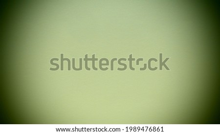 light green background with dark vignetting around the edges of the image.