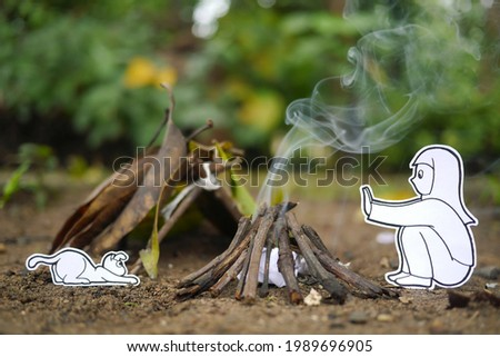semi illustration picture of a girl and her cat sitting next to a campfire and their tent on a camping ground