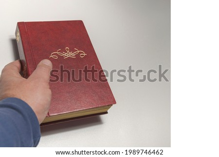 Old brown book in hand with monogram Free space for title. Banner of card