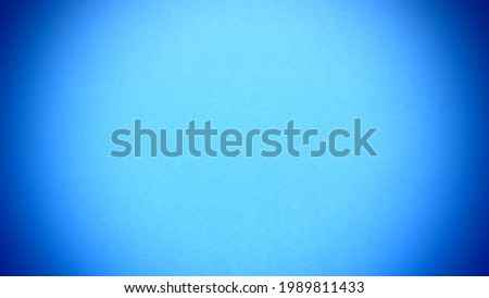 Sky blue background with vivid dark blue vignetting around the edges of the image.