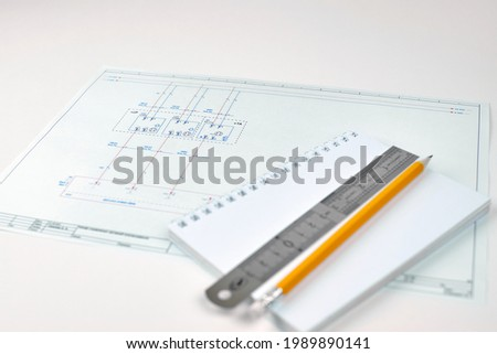Printed circuit diagram. Engineer's drawing, close-up. Wiring diagram of electrical sensors. Design concept, electronics and engineering. Wiring diagram, close-up. Engineer's workplace. Royalty-Free Stock Photo #1989890141