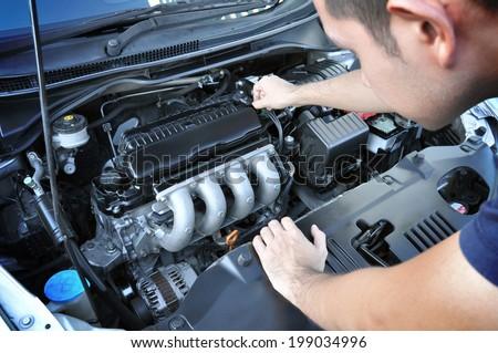 A man checking car engine #199034996