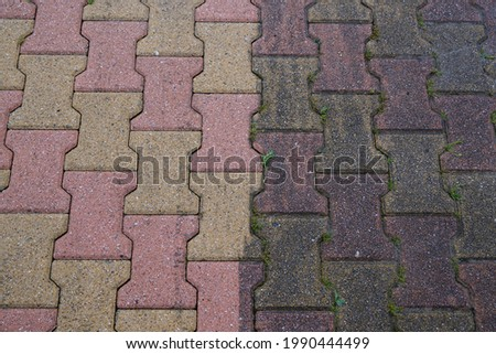 garden paved path floor slabs interlock half clean and dirty after an anti-foam cleaning Royalty-Free Stock Photo #1990444499