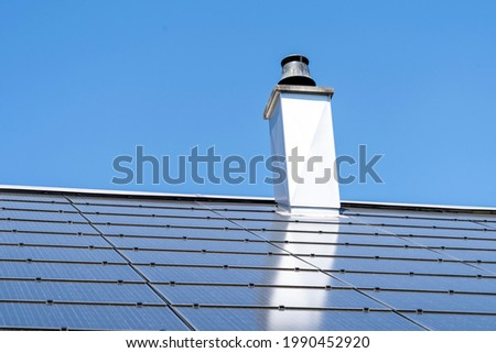 Photo-voltaic panels on house roof. Solar energy, eco friendly, earth day concept. Clean electric green energy from renewable source.
