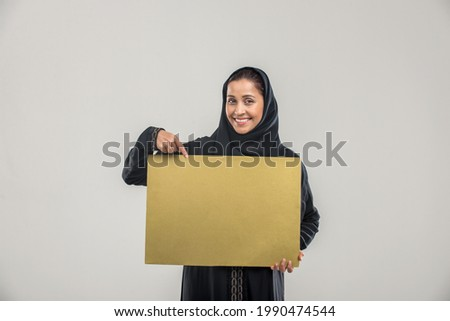 Portrait of arabic woman with abaya dress in a studio Royalty-Free Stock Photo #1990474544
