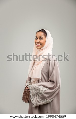 Portrait of arabic woman with abaya dress in a studio Royalty-Free Stock Photo #1990474559