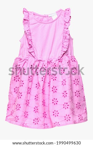 Summer dress isolated. Closeup of a beautiful pink sleeveless baby girl dress isolated on a white background. Children spring fashion. Macro.