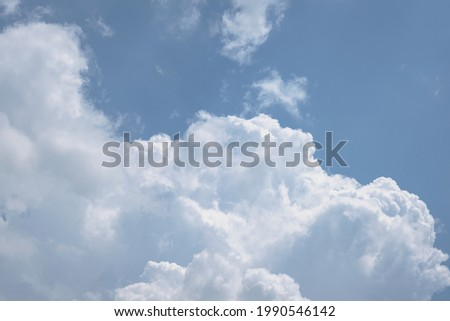 Dense, full-bodied mass of white clouds in a celestial sky, free space for text. Royalty-Free Stock Photo #1990546142