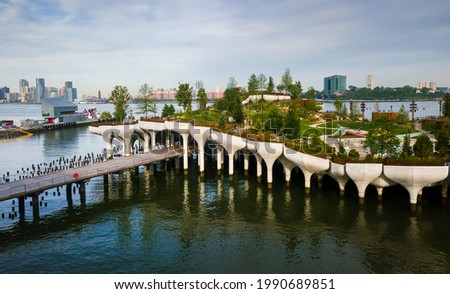 Little Island park at Pier 55 in New York, an artificial island park in the Hudson River west of Manhattan in New York City, adjoining Hudson River Park aerial view Royalty-Free Stock Photo #1990689851
