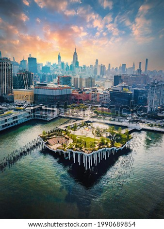 Little Island park at Pier 55 in New York, an artificial island park in the Hudson River west of Manhattan in New York City, adjoining Hudson River Park aerial view Royalty-Free Stock Photo #1990689854
