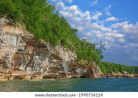 Landscape of the mineral stained, sandstone and eroded shoreline of Lake Superior, Pictured Rocks National Lakeshore, Michigan's Upper Peninsula, USA