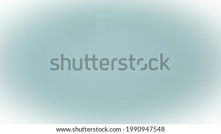 light blue background with white vignetting around the edges of the image.