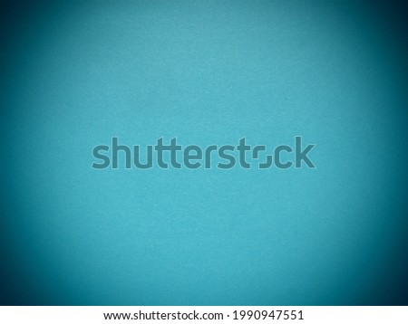 blue background with dark vignetting around the edges of the image.