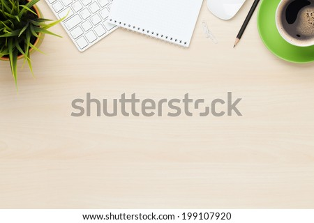 Office table with notepad, computer and coffee cup. View from above with copy space Royalty-Free Stock Photo #199107920