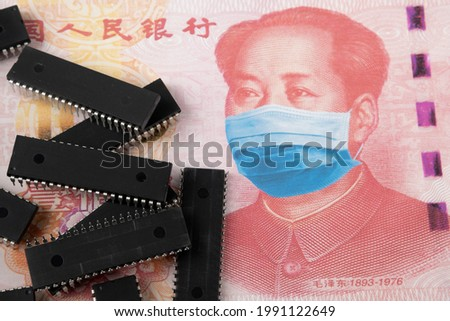 Microchips shortage in China because of COVID-19 pandemic. Concept. Picture of computer chips placed on banknote with applied anti virus face mask (applied by digital montage).