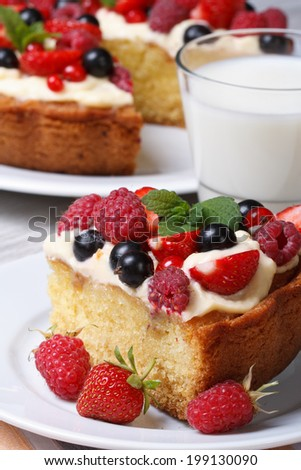 piece of berry pie with raspberries, strawberries on a plate, and milk close up vertical  #199130090