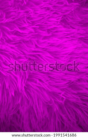 Bright color furry texture backdrop close up. Texture of wool skin. Abstract animal fur background. Hairy pattern for design. Fabric copy space colored background Royalty-Free Stock Photo #1991541686