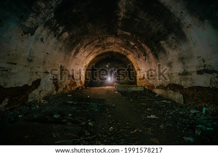 Large old historical underground red brick tunnel. Royalty-Free Stock Photo #1991578217