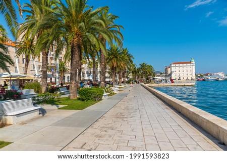 People are walking on seaside promenade in Split, Croatia Royalty-Free Stock Photo #1991593823