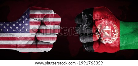 United States Vs Afghanistan with Fists Pointing Towards Each Other Representing on Going Tension between two countries. War Concept backdrop with world map in the back Royalty-Free Stock Photo #1991763359