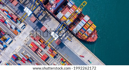 Top view of International Container  ship loading and unloading at sea port, Freight Transportation, Shipping, Nautical Vessel. Logistics, import export, oversea Transportation. Royalty-Free Stock Photo #1992262172