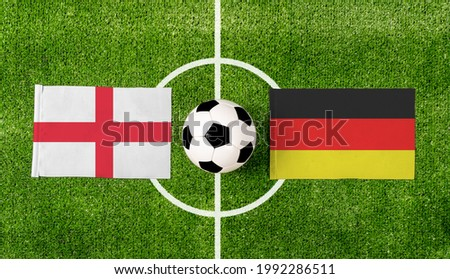 Top view soccer ball with England vs. Germany flags match on green football field. Royalty-Free Stock Photo #1992286511