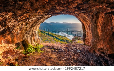 Fantastic view from the cave of Bovilla Lake, near Tirana city located. Superb spring landscape. Unbelievable outdor scene of Albania, Europe. Beauty of nature concept background. Royalty-Free Stock Photo #1992487217
