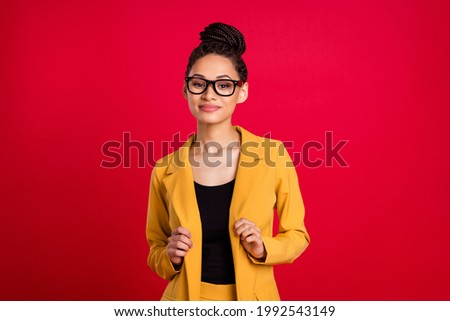 Photo of nice millennial lady touch cardigan wear eyewear isolated on vivid red color background Royalty-Free Stock Photo #1992543149