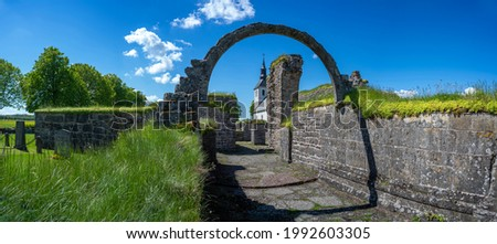 Gudhem Historical Monastery Ruin and Church with overgrown stone wall and arches Royalty-Free Stock Photo #1992603305