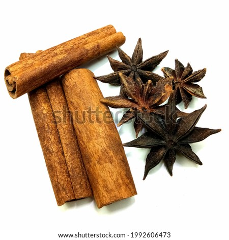 This is picture of spices and herbs namely cinnamon and star anise. They are used as an aromatic condiment and flavouring additive in cuisines, desserts and traditional foods.
