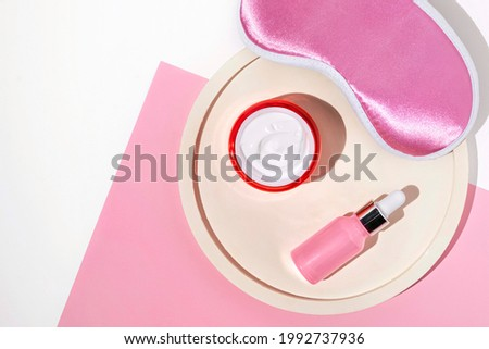 Night face care routine concept. top view sleeping mask, moisturizer cream, serum lotion Royalty-Free Stock Photo #1992737936