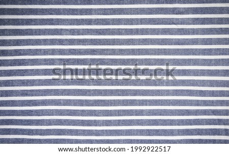 Dark blue and white stripes fabric background. Royalty-Free Stock Photo #1992922517