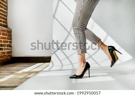 Fashionable woman in black shiny heels Royalty-Free Stock Photo #1992950057