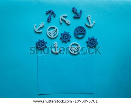 Blue envelope with anchor, boat, steering wheel inside on a blue background.