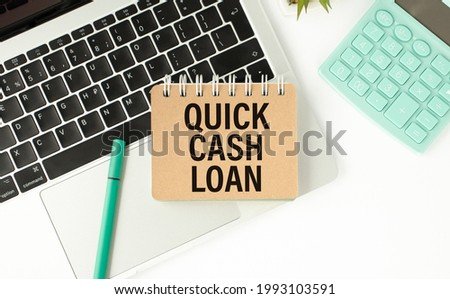 QUICK CASH LOAN - Top view notebook writing on the laptop,business