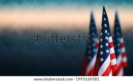Happy Veterans Day background, American flags against a blue fog background, November 11, American flag Memorial Day, 4th of July, Labour Day, Independence Day. Royalty-Free Stock Photo #1993169381