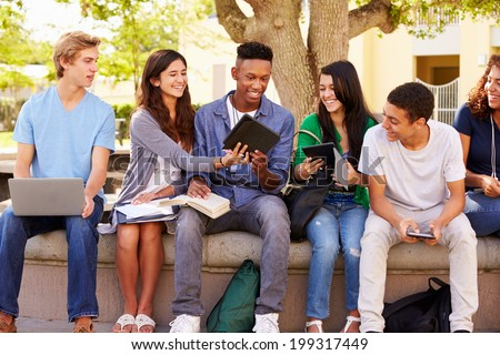 High School Students Collaborating On Project On Campus Royalty-Free Stock Photo #199317449