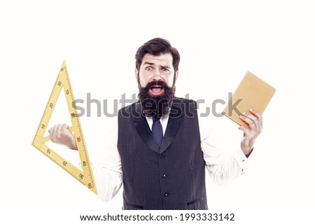 Be wise guy, give math try. Scared man back to school. Bearded man hold book and triangle. Brutal man ready for geometry lesson. Technical man or engineer isolated on white. Geometric drawing