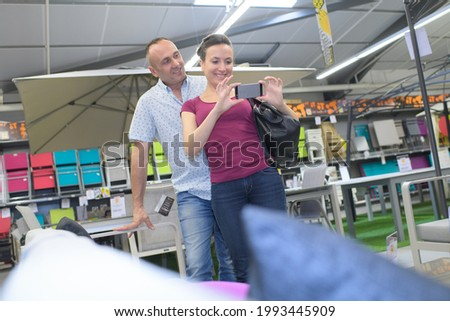 a customer photographing a product