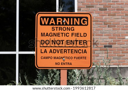 WARNING STRONG MAGNETIC FIELD DO NOT ENTER sign at a hospital. Danger for people with pacemakers, hearing aids, cell phones or pagers.