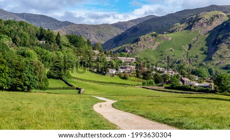 Coniston village and surrounding mountains viewed from a public footpath from Coniston during early summer in the Lake District Royalty-Free Stock Photo #1993630304